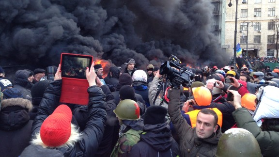"""David Solomon, who was visiting Ukraine, spotted heavyweight boxer Vitali Klitschko (shown in the center wearing a fur hat) at a January 23 protest in Kiev. """"This high-profile person came to this seemingly menacing environment to show his supporters that he does indeed stand by them, and he literally did."""""""