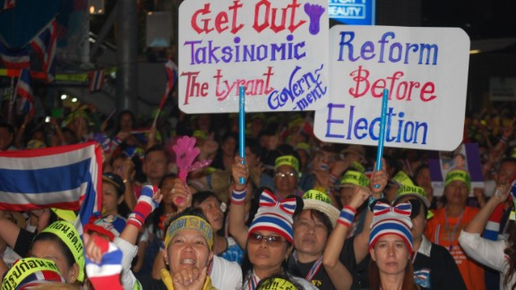 """Surasak Yiengjuntuek was at a January 26 demonstration in Bangkok after anti-government protest leader Suthin Thararin was shot and killed. The yellow headbands show a rallying cry for the current leader of the protests, Suthep Thaugsuban. """"Suthep, fight fight,"""" the headbands read."""