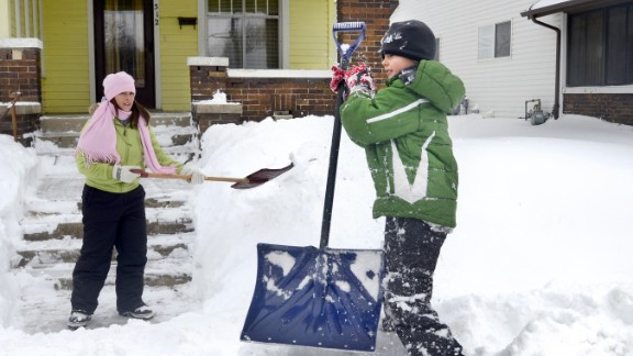 Students in Rossville, Indiana, will be attending school on Saturdays to make up for 10 snow days the district had called by mid-February, CNN affiliate WLFI reported. Here, a mother and child cleared snow in northern Indiana after several inches fell in early February.