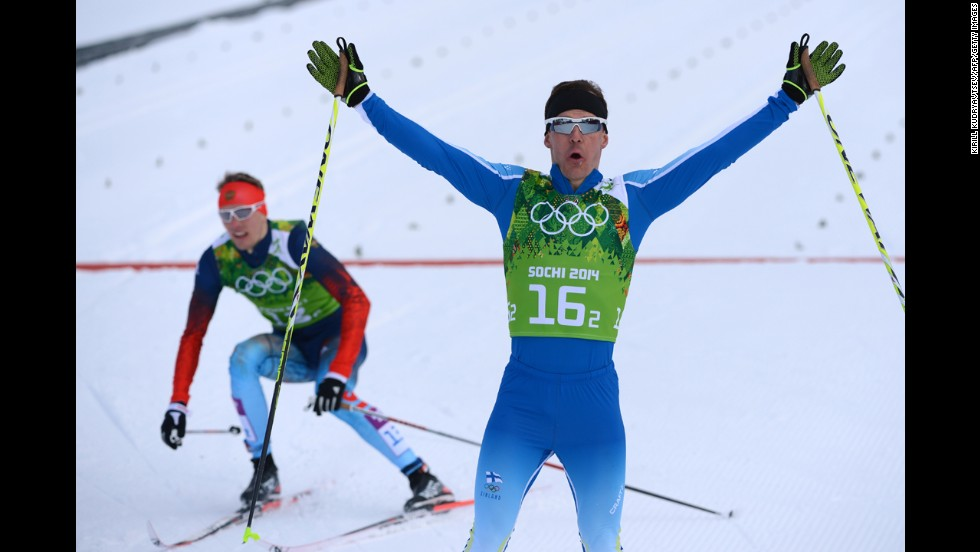 Finnish cross-country skier Sami Jauhojarvi, right, celebrates gold in the men's team sprint classic on February 19.