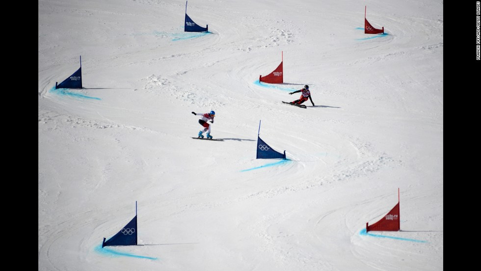 Switzerland's Ladina Jenny and Canada's Marianne Leeson compete in parallel giant slalom on February 19.