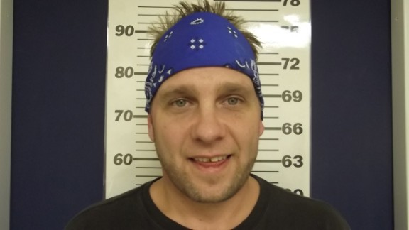 3 Doors Down bassist Todd Harrell smiles for his mugshot after being charged with driving under the influence. He joins the club of other smiling celebs: