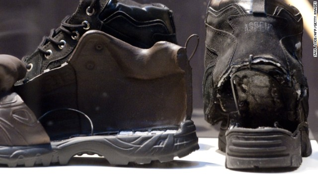 The shoes used in the failed attempt to blow up an airplane by shoe bomber Richard Reid (R) are displayed alongside an FBI model of the shoe filled with explosives, as part of a new exhibit marking the tenth annivesary of the September 11, 2001 attacks, at the Newseum in Washington, DC, as seen August 31, 2011. The exhibit, 'War on Terror: The FBI's New Focus,' illustrates the story of the FBI's changing mission after 9/11 and features more than 60 artifacts including from the first World Trade Center bombing in 1993 and pieces of the engines and landing gear of United Airlines Flight 175, which hit the South Tower of the World Trade Center. AFP PHOTO / Saul LOEB (Photo credit should read SAUL LOEB/AFP/Getty Images)