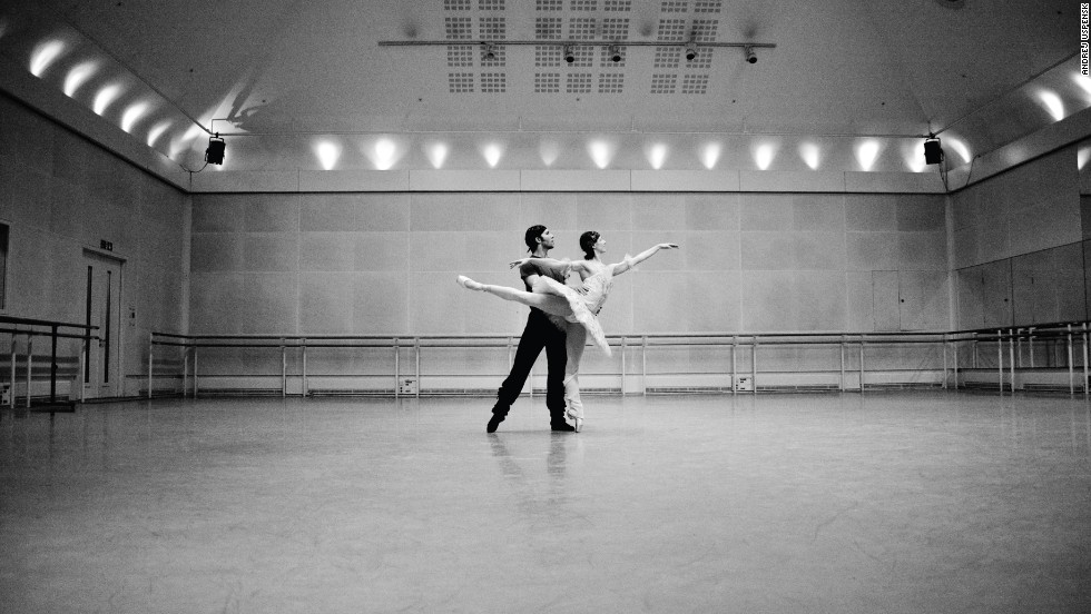 The book includes intimate portraits of the off-stage lives of  dancers including Tamara Rojo, Carlos Acosta, and Federico Bonelli. Here, <strong>Alina Cojocaru</strong> and fiancee <strong>Johan Kobborg</strong> rehearse.