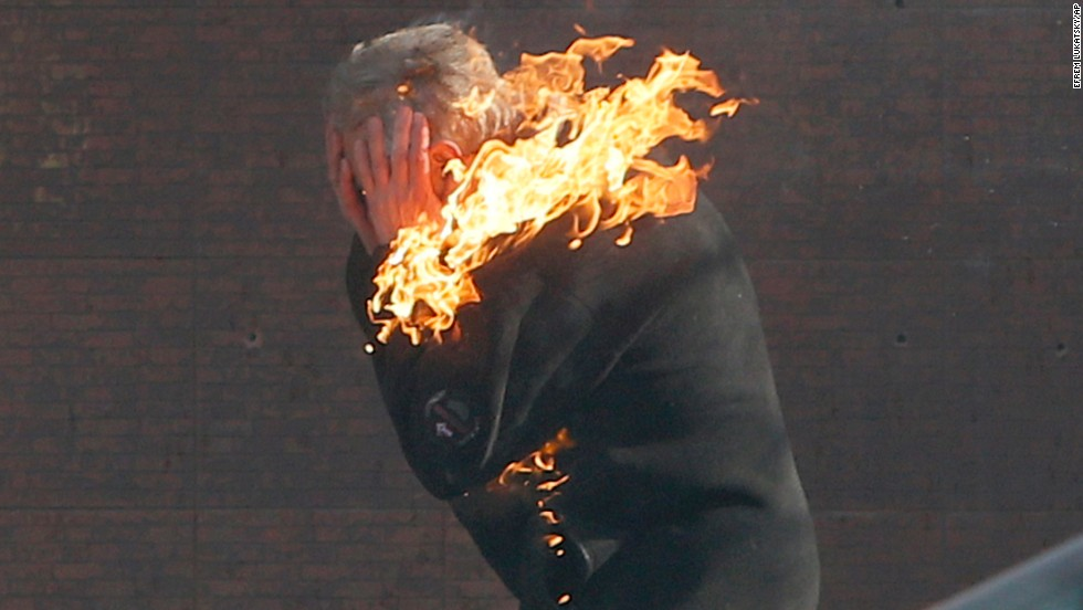 "A protester is engulfed in flames during clashes with riot police outside Ukraine's parliament in Kiev on February 18. <a href=""http://www.cnn.com/2014/02/19/world/gallery/ukraine-protests-0218/index.html"">Violence has intensified</a> in Kiev's Independence Square, which has been the center of anti-government protests for the past few months."