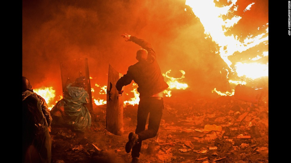 A protester throws a Molotov cocktail in Kiev on February 19.