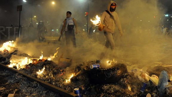 Protesters light fires during an anti-government demonstration in Caracas on Wednesday, February 19.