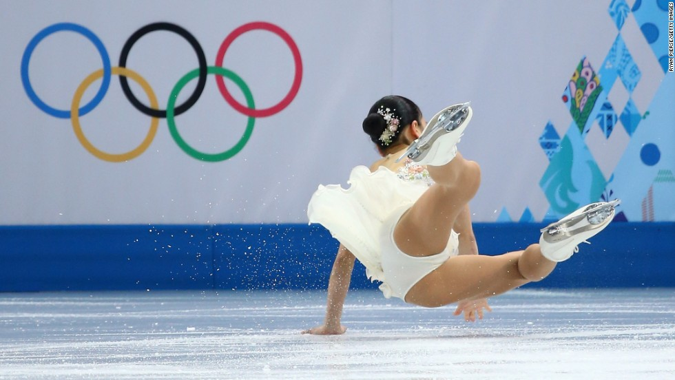 Akiko Suzuki of Japan falls during the figure skating competition February 20.