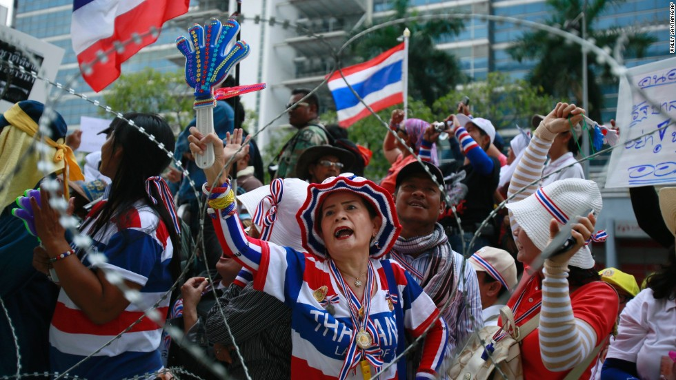 Protesters shout slogans demanding Yingluck's resignation on February 19.