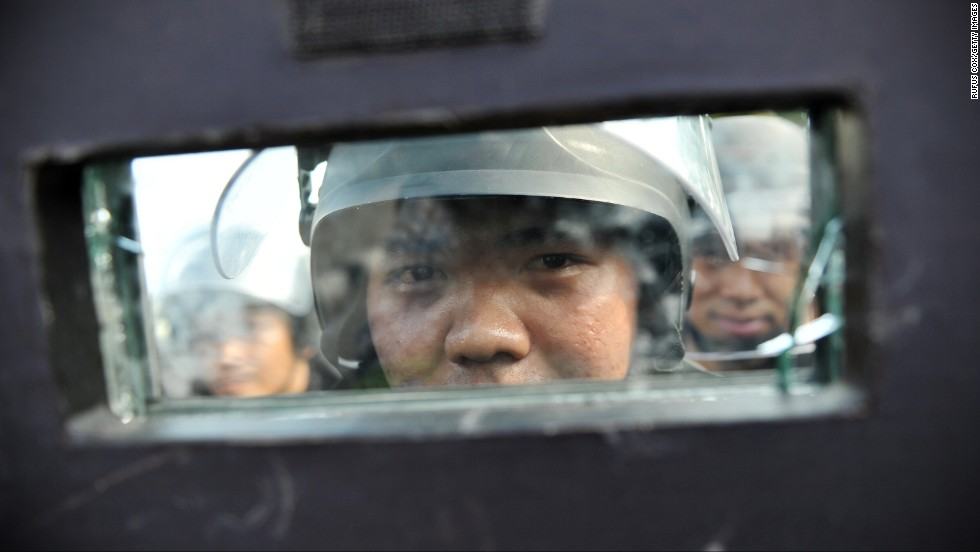 Riot police stand guard in Bangkok on February 14.