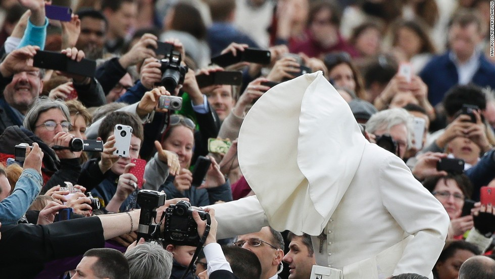 A gust of wind blows Pope Francis' mantle as he arrives to lead his Wednesday general audience in St. Peter's Square at the Vatican on February 19.