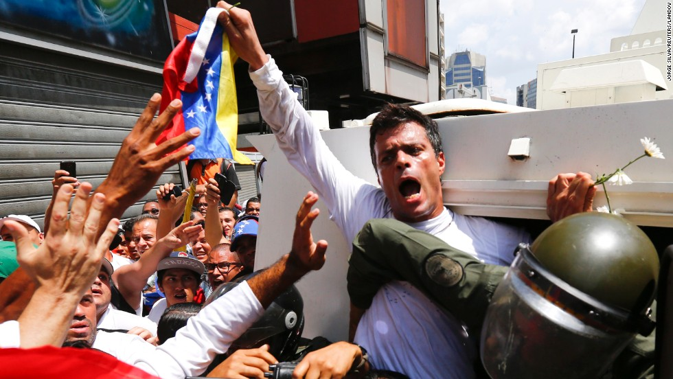 "Venezuelan opposition leader Leopoldo Lopez is placed into a National Guard armored vehicle in Caracas on February 18. The Latin American country's government blames him for <a href=""http://www.cnn.com/2014/02/18/world/gallery/venezuela-protests/index.html"">inciting clashes</a> that have left at least five people dead."
