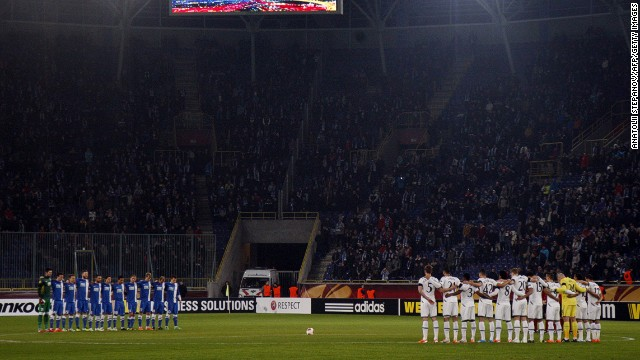 Spurs and FC Dnipro players line the center circle to observe a minute's silence before Thursday's Europa League tie.