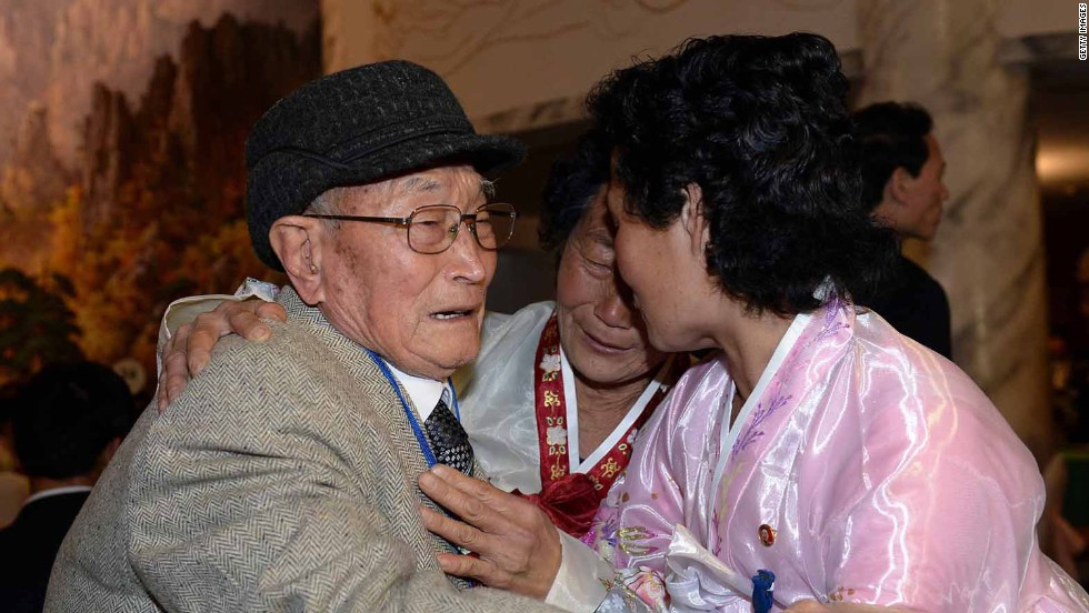 Families torn apart for more than 60 years -- separated by the Korean War -- were given the chance to reunite for few hours at a mountain resort. Here, South Korean Ryu Young-Shik (L), 92, meets with his North Korean relatives.