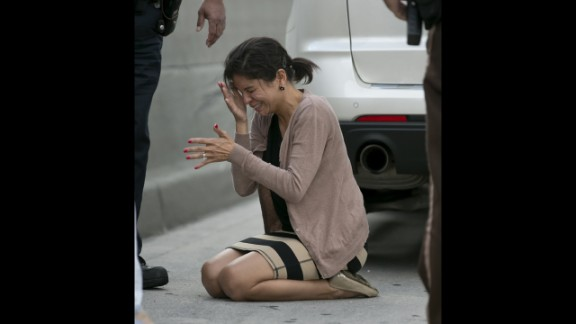 A distraught Rauseo reacts after performing CPR. Miami Herald Photographer Al Diaz was among those stuck in traffic. He went looking for help and found it coming from all sides. He then snapped into photographer mode and began documenting what he saw.