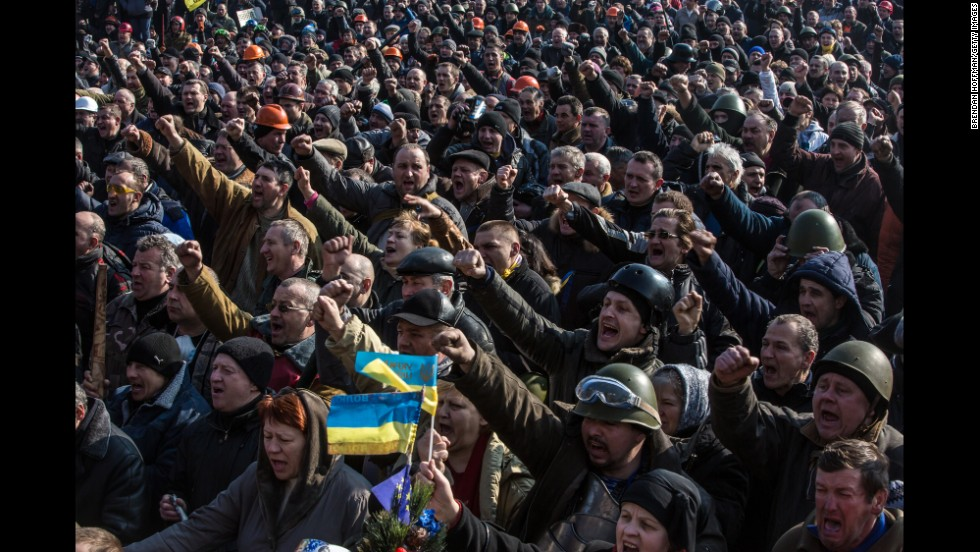 "Ukrainian demonstrators gather in Kiev's Maidan, or Independence Square, on February 21, 2014, a day after the bloodiest day of revolution protests. <a href=""http://www.cnn.com/2015/02/20/europe/ukraine-conflict/index.html"">Nearly 50 activists were killed and hundreds more injured in clashes </a>in the square on February 20, 2014. The street protests soon led to the ouster of pro-Russian President Viktor Yanukovych and triggered a chain of events that included Russia's annexation of Ukraine's Crimean Peninsula and fighting in Eastern Ukraine with pro-Russian separatist forces."
