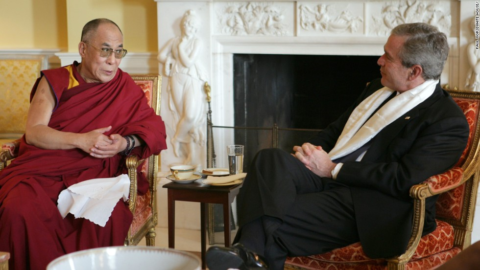 President George W. Bush, wears a scarf that was presented to him by the Dalai Lama at the White House in November 2005.