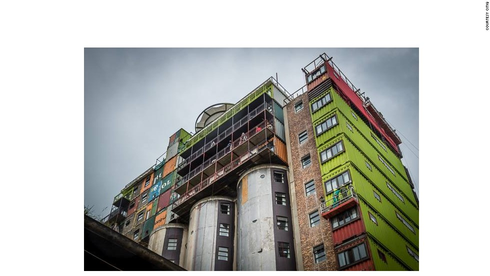 A developer in the city of Johannesburg, South Africa, has stacked old shipping containers atop a grain silo to create trendy new apartments.