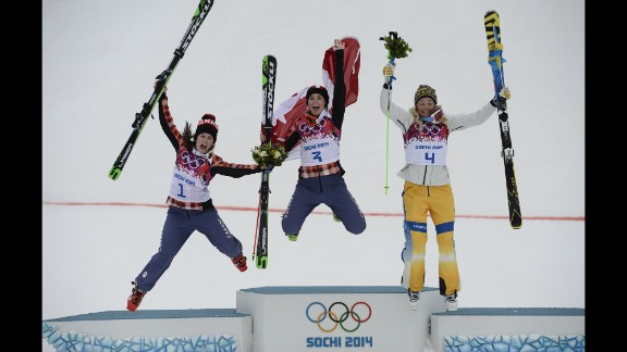 From left, silver medalist Kelsey Serwa of Canada, gold medalist Marielle Thompson of Canada, and bronze medalist Anna Holmlund of Sweden celebrate on the podium after the women