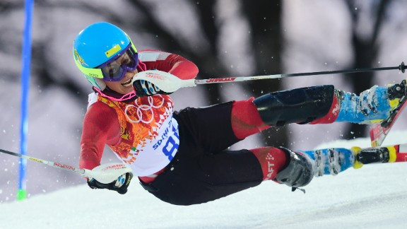 Iranian skier Forough Abbasi falls during the women