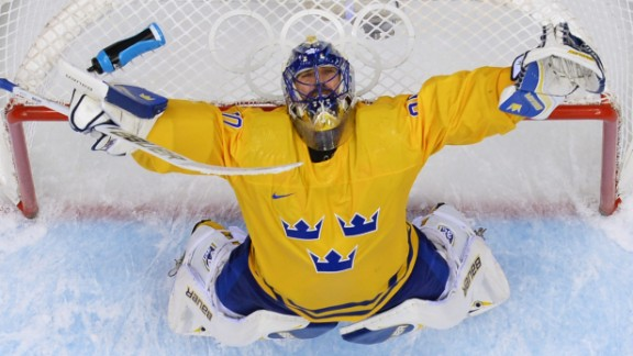 Swedish goaltender Henrik Lundqvist celebrates his team