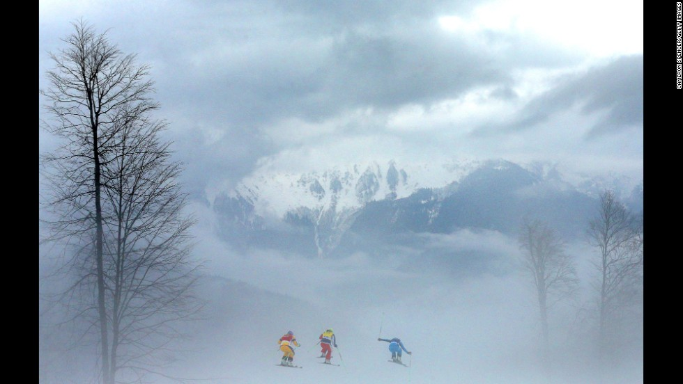 Athletes compete in heavy fog during the women's ski cross quarterfinals on February 21.