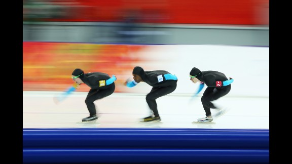 From left, American speedskaters Jonathan Kuck, Shani Davis and Brian Hansen compete in the men