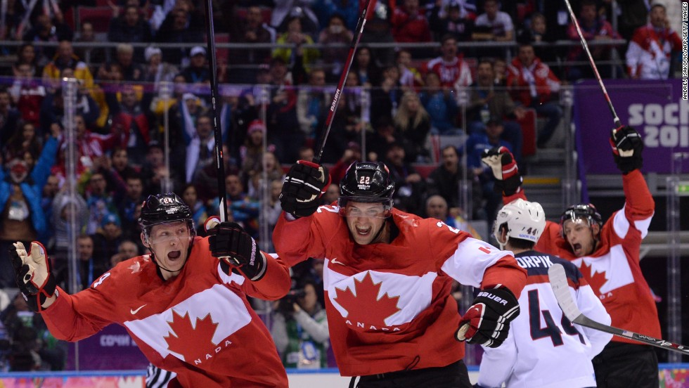 Canada's Jamie Benn, second from left, celebrates scoring the only goal in the men's hockey semifinal between Canada and the United States on Friday, February 21.