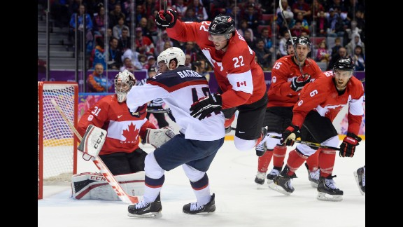 Players look toward the corner of the rink during the hockey semifinal between Canada and the United States.