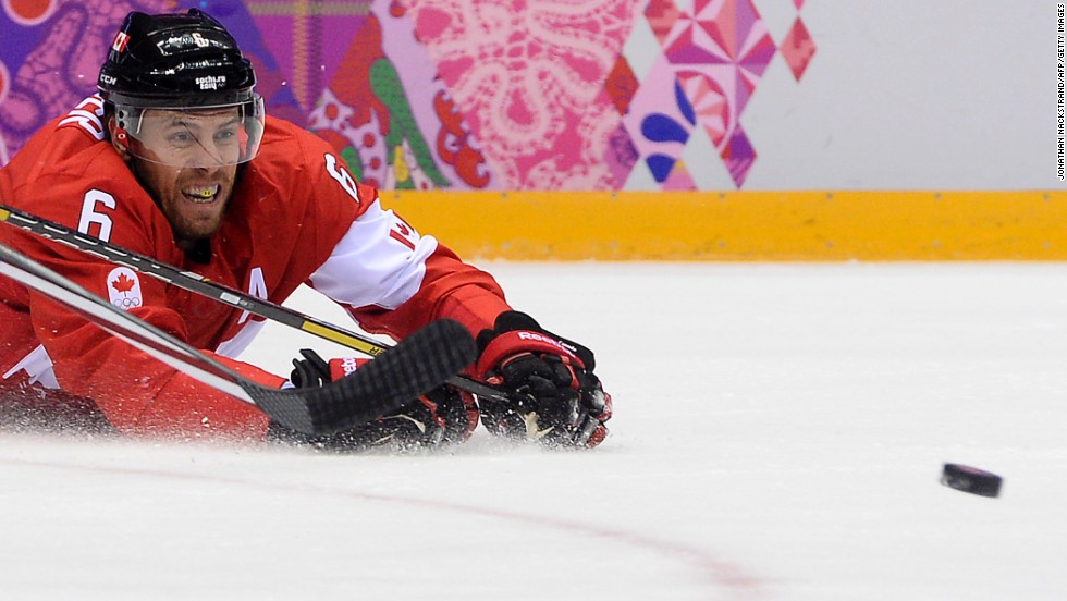Canada's Shea Weber grimaces as he falls down during the hockey semifinal against the United States on Friday, February 21.