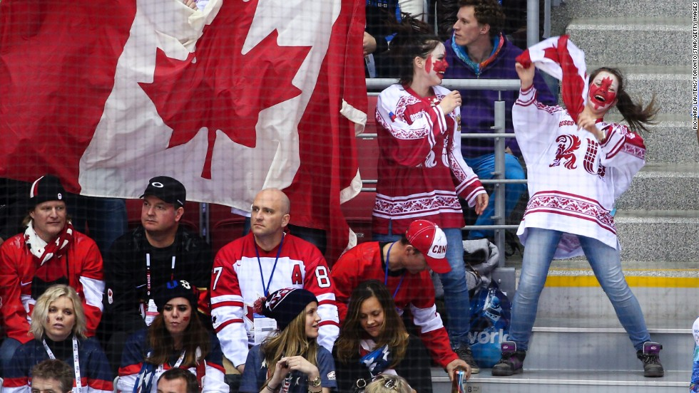 Fans celebrate Canada's 1-0 defeat of the United States.