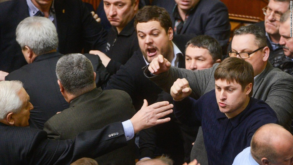 Ukrainian lawmakers argue during a session of Parliament on Friday, February 21.