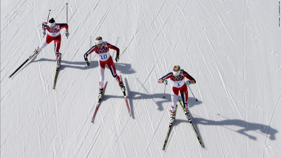 From left, gold medal winner Marit Bjoergen, bronze medal winner Kristin Stoermer Steira and silver medal winner Therese Johaug, all from Norway, ski during the  30-kilometer cross-country race on February 22.
