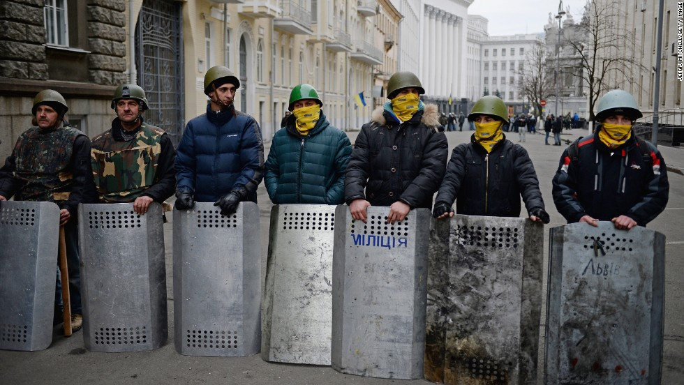 Anti-government protesters guard the streets next to the presidential offices in Kiev on February 22.