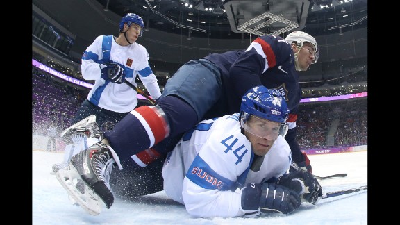 Ryan McDonagh of the United States falls on top of Kimmo Timonen of Finland on February 22 during the first period of the men