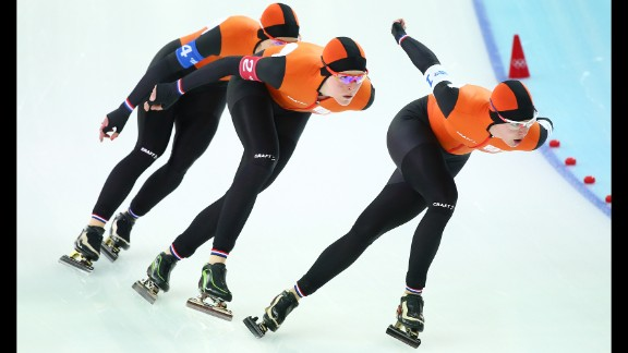Ireen Wust, Jorien ter Mors and Marrit Leenstra of the Netherlands compete during the semifinals of the women