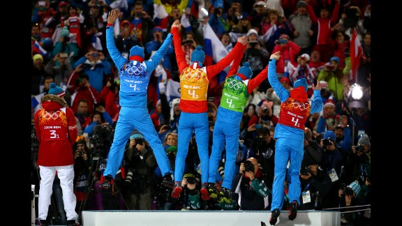 Gold medalists Anton Shipulin, Dmitry Malyshko, Evgeny Ustyugov and Alexey Volkov of Russia celebrate on the podium during the medal ceremony for the men