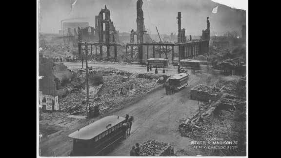 """It's hard to believe Chicago started out as a small trading post at the mouth of the Chicago River. It incorporated as a city on March 4, 1837, and grew exponentially in the decades that followed. Most of its buildings were made of wood. During the dry summer of 1871, a massive fire broke out, destroying more than 17,000 buildings across Chicago and killing 300 people. The cause of the fire was never determined. This photo shows the fire's devastation at the corner of State Street and Madison Street.  Editor's note: An earlier version of this gallery had an image of downtown Chicago that was removed because its authenticity was in question. After further review with the source, CNN found the image was misrepresented as an historical photograph. It was in fact a still from the 1937 movie """"In Old Chicago."""" CNN regrets the error."""