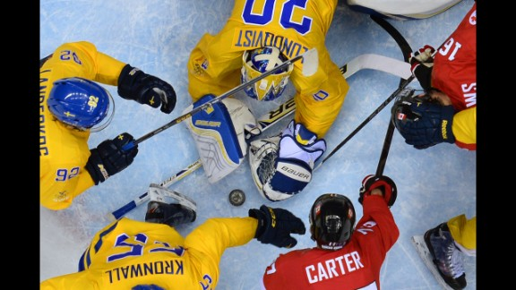 Swedish goalie Henrik Lundqvist makes a save during the hockey final against Canada on February 23.