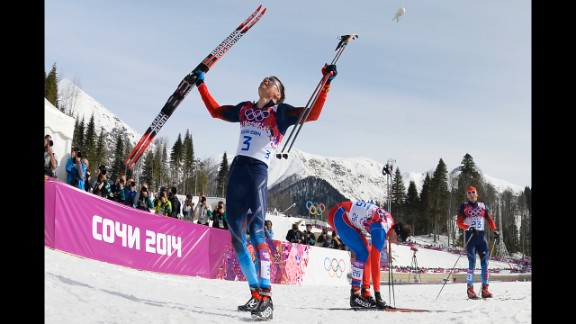 Alexander Legkov of Russia celebrates his win in the men