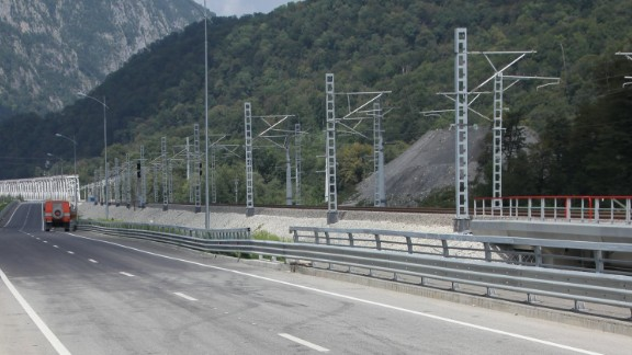 """The so-called """"Most Expensive Road In The World' runs 25 miles from the coastal Winter Games site in Sochi to the alpine venues nearly 2000 feet above sea level in Krasnaya Polyana, Russia. The Wall Street Journal valued its cost at $9 billion though Oleg Toni, Russian Railways Vice President, would not confirm this figure."""