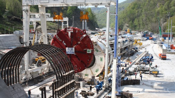 """Six huge boring machines (like the one pictured) and 14 """"harvesters"""", which transport the rubble and soil away from the mountain face, along with various drilling and blasting methods were used to drive 30 kilometers of tunnel through the mountains."""