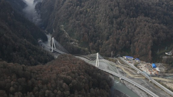 By working with consultants from Italy, Spain and Switzerland a 37 km flyover has been constructed, across all impediments, to deliver travelers from one end to the other in around 30 minutes when free of traffic .