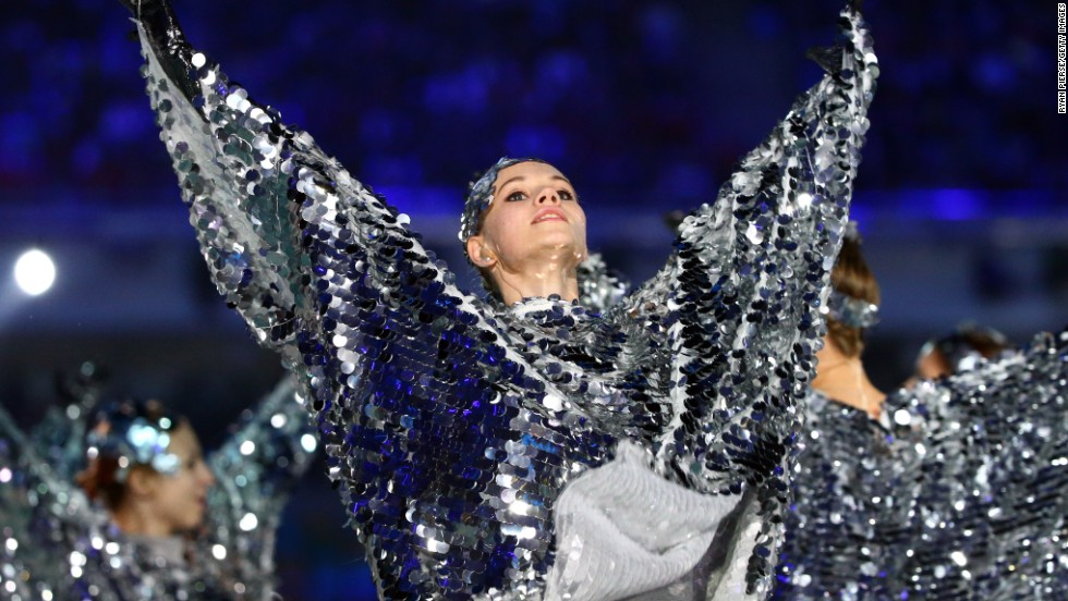 A dancer gleams during the closing ceremony.
