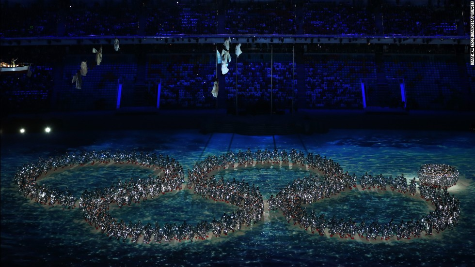 Dancers deliver a nod to the malfunction of an Olympic ring during the opening ceremony.
