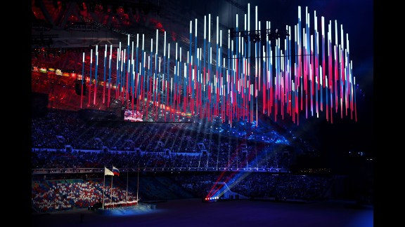 The Olympic and Russian flags are raised as the Russian national anthem is sung.