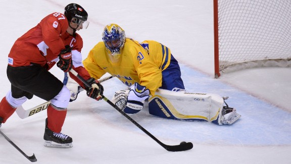The Canadians also won the men's ice hockey title. Here Sidney Crosby scores past Sweden's goalkeeper Henrik Lundqvist during the final at the Bolshoy Ice Dome.