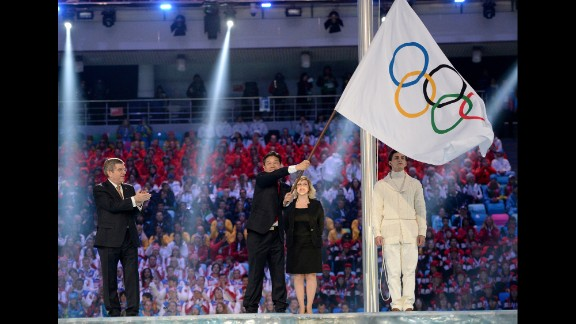 The Olympic flag is handed over to Lee Seok-rai, mayor of Pyeongchang.