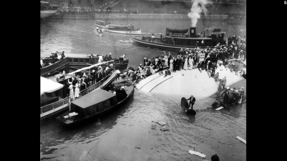 One of the worst tragedies to strike Chicago happened on July 24, 1915, when the SS Eastland capsized in the Chicago River with 2,500 passengers aboard. The passenger ship was docked at the time. The cause of the disaster is still unclear. Some have speculated that the Eastland had a faulty ballast system or additional lifeboats that made it top-heavy. More than 840 people died after passengers spilled into the river, while others -- mostly women and children -- were trapped in underwater cabins. Here, survivors stand atop the capsized vessel.