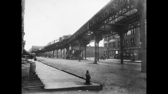 """Chicago's famous """"L"""" (short for """"elevated"""" train) started moving residents around town in 1892. That makes it the second-oldest transit system in the country behind the one in Boston. Here, a steam-powered """"L"""" train comes down the railway on Market Street near Lake Street on June 30, 1895."""